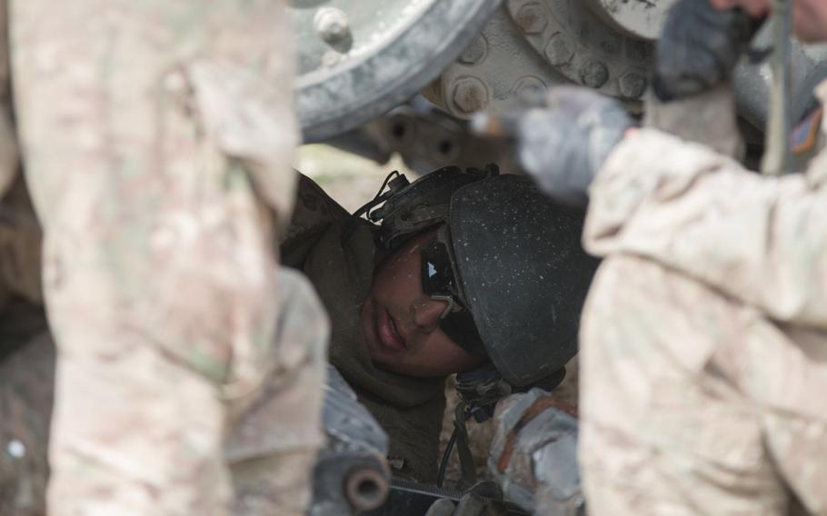 U.S. Army Spc. Diego Magana tightens a bolt on a M1A2 Abrams battle tank during a drill held on Wednesday, May 11, 2016, as part of the 2016 Strong Europe Tank Challenge held at the Grafenwoehr, Germany training area.