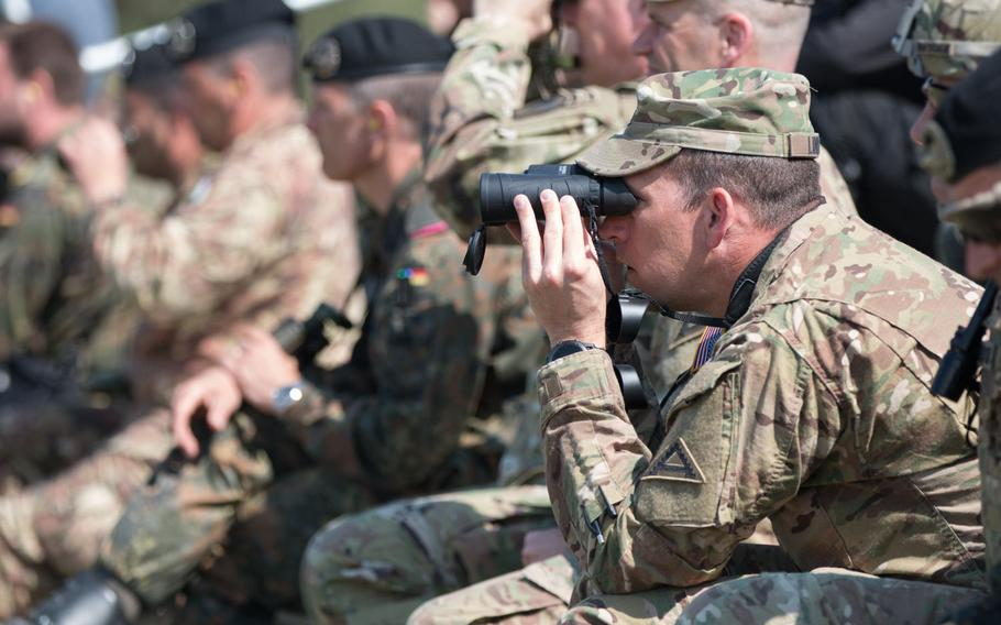 U.S. Army Col. Clark Lindner scopes out the Italians' firing precision during their firing drill held as part of the 2016 Strong Europe Tank Challenge on Wednesday, May 11, 2016, at the Grafenwoehr, Germany training area.