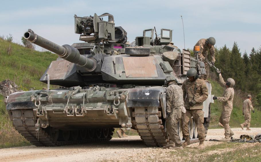 American tankers from 2nd Battalion, 7th Infantry Regiment, Company D, practice replacing the treads on their M1A2 Abrams battle tank on Wednesday, May 11, 2016, during the 2016 Strong Europe Tank Challenge held in Grafenwoehr, Germany.