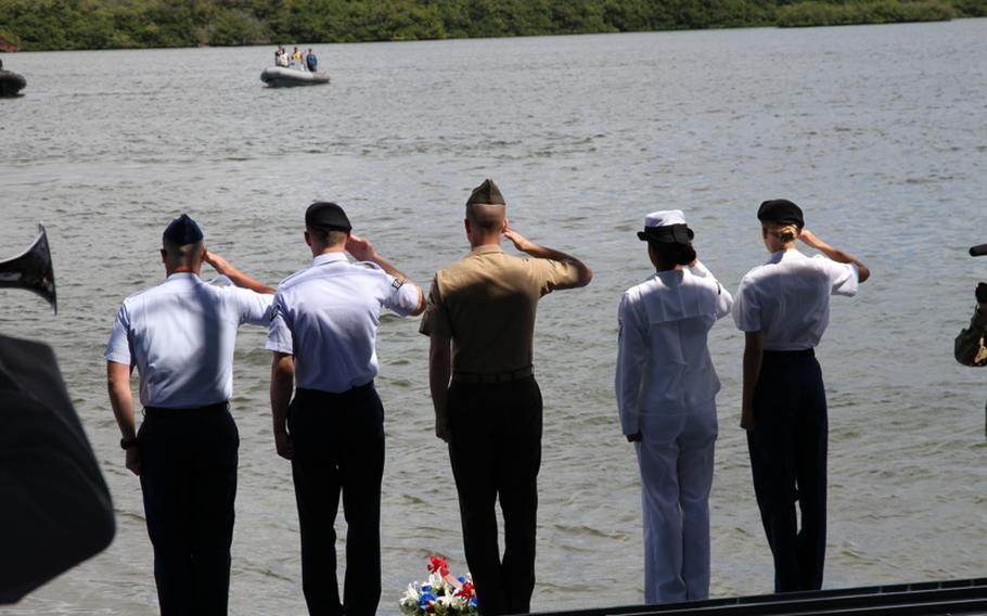 Representatives of each service salute while taps is played aboard the LTG William B. Bunker in Pearl Harbor, May 20, 2016, during a ceremony commemorating the West Loch disaster of 1944.