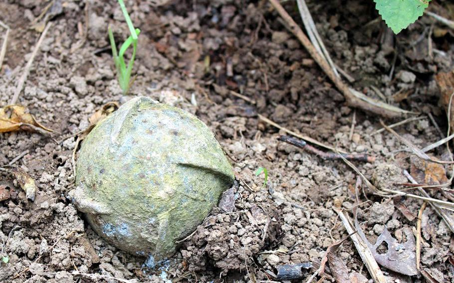 A BLU26 cluster bomb lies after being uncovered by a Project RENEW team on March 6, 2016. Since the Vietnam War ended in 1975, cluster munitions have accounted for nearly 40 percent of the casualties in Quang Tri Province.
