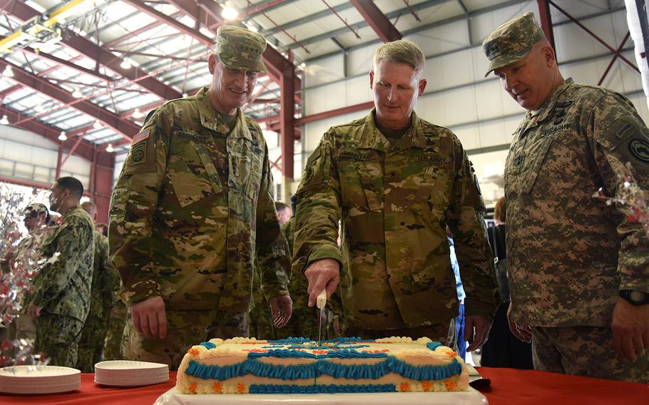 (From the left) U.S. Army Gen. David M. Rodriguez, U.S. Africa Command commanding general, Brig. Gen. Kurt Sonntag, new Combined Joint Task Force-Horn of Africa commanding general, and Maj. General Mark Stammer, departing CJTF-HOA commanding general, cut a cake during a change of command ceremony post-reception April 13, 2016, at Camp Lemonnier, Djibouti.