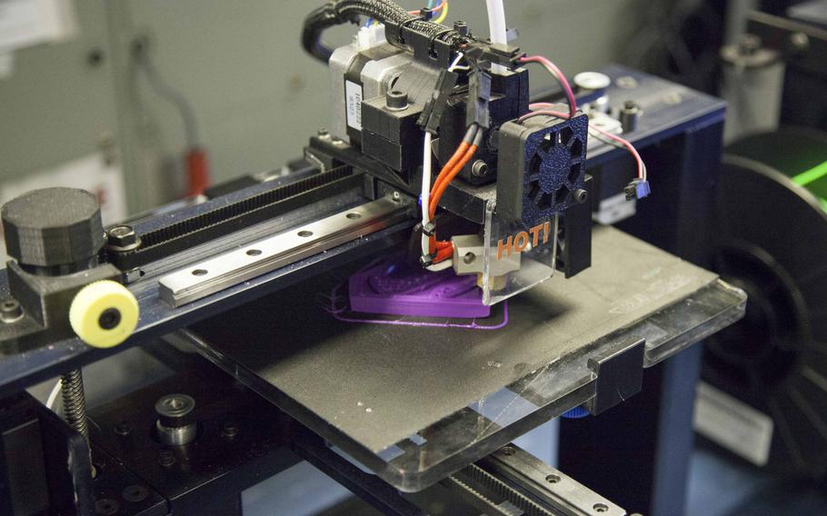 A 3D Printer aboard the aircraft carrier USS Harry S. Truman printing a design April 25, 2016.