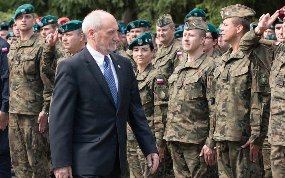 Polish Defense Minister Antoni Macierewicz passes by a formation of Polish and American soldiers during the opening ceremony of the multinational training exercise Anakonda 16 in Warsaw, Poland, Monday, June 6, 2016.