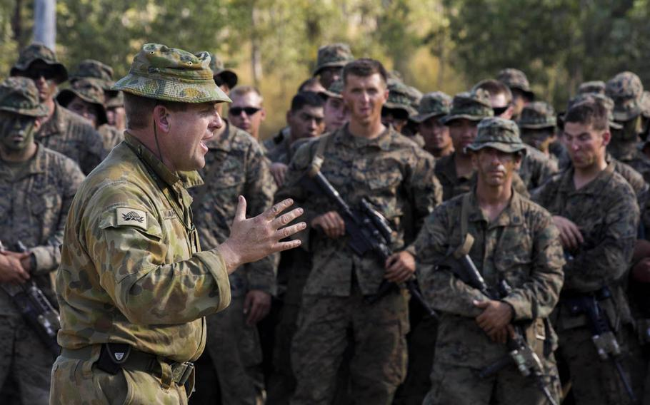 Lt. Col. Jim McGann, commanding officer of the Australian Army's Battle Group Waratah, 8th Brigade, thanks U.S. Marines and members of the Japan Ground Self-Defense Force for their training during Exercise Southern Jackaroo at Shoalwater Bay, Queensland, Australia, May 26, 2016.