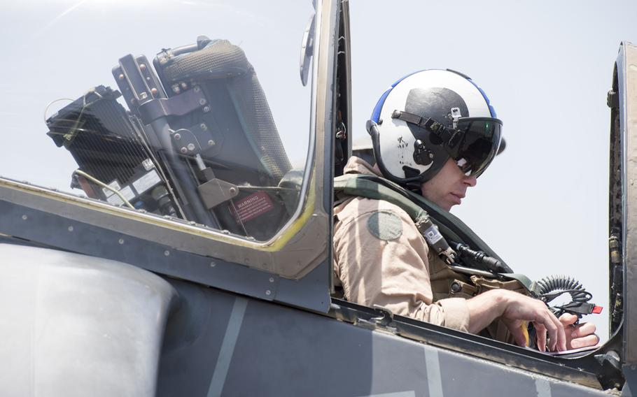 A 13th Marine Expeditionary Unit AV-8BII Harrier pilot prepares for the first airstrikes launched from the amphibious assault ship USS Boxer against the Islamic State group on Thursday, June 16, 2016.  The sorties from the Boxer mark the first time during Operation Inherent Resolve the U.S. Navy has conducted airstrikes from the Persian Gulf and the Mediterranean at the same time.