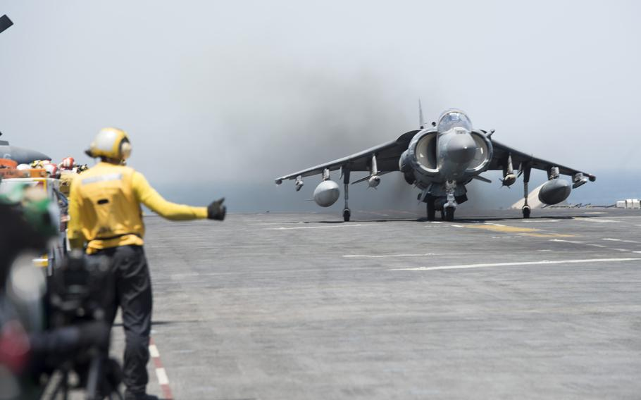 A Marine Expeditionary Unit AV-8BII Harrier launches from the amphibious assault ship USS Boxer on Thursday, June 16, 2016, targeting Islamic State group militants.