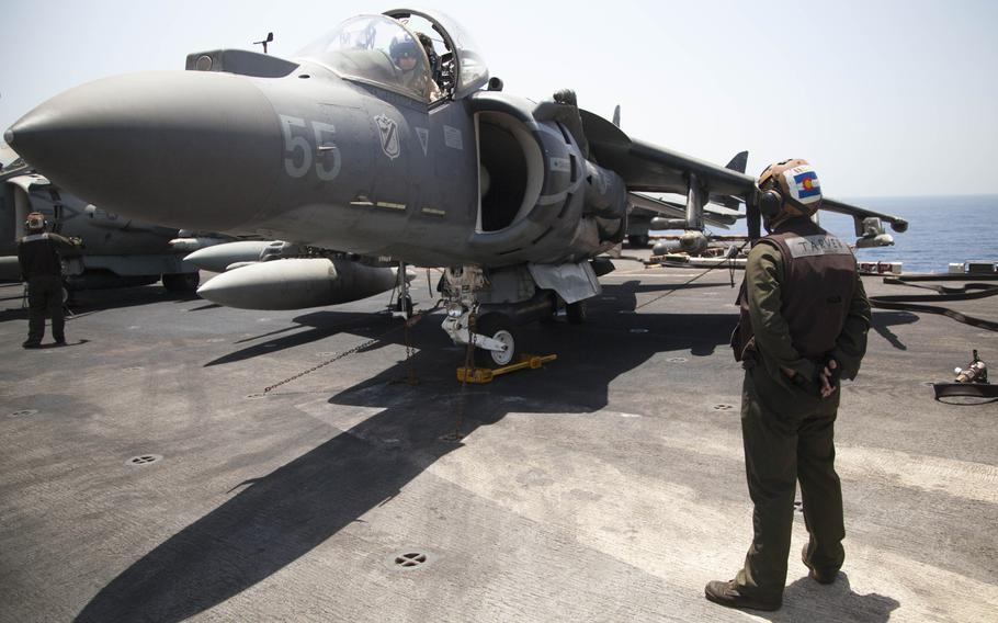 Lance Cpl. Blake Tarver, a plane captain for the 13th Marine Expeditionary Unit embarked on the amphibious assault ship USS Boxer, prepares an AV-8BII Harrier prior to conducting the first aircraft sorties launched from the ship against the Islamic State in Iraq and Syria on Thursday, June 16, 2016.