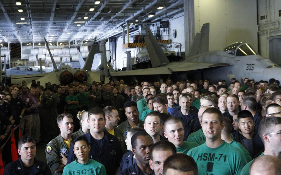 Hundreds of crew members of the USS John C. Stennis gather for an all-hands call by Vice President Joe Biden July 14, 2016, as the aircraft carrier sailed about 140 miles south of Oahu, Hawaii.