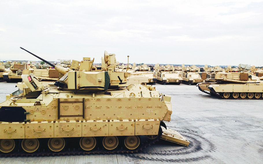 U.S. Army armored vehicles sit at Coleman Barracks in Mannheim, Germany, Tuesday, Sept. 1, 2015. In October, USAREUR will move into Tower Barracks, a former British facility in the northwestern German town of Duelmen, to store tanks and other combat equipment flowing into Europe as part of a Pentagon plan to position more firepower on the Continent.