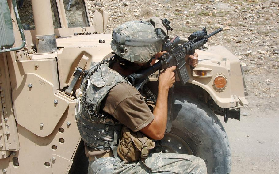 Staff Sgt. Jason Geranen, of F Company, 2nd Battalion, 82nd Aviation Brigade (Long Range Surveillance Detachment), engages a Taliban fighting positions near the village of Allah Say, Afghanistan.