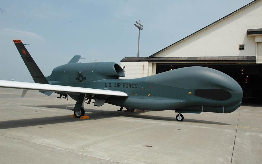 A Global Hawk unmanned surveillance drone is parked at Misawa Air Base, Japan, in 2014. Because of bad weather, two Guam-based Global Hawks landed at Kadena Air Base on Okinawa, Monday, Aug. 1, 2016.
