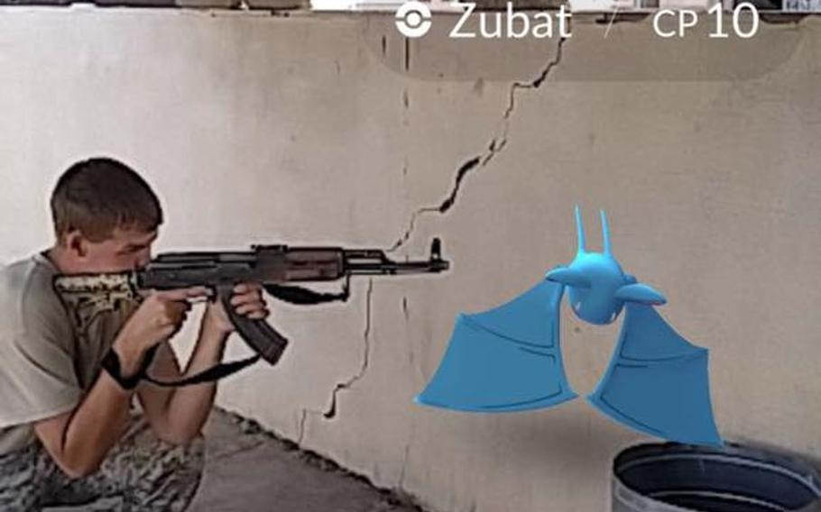 A fighter aims an AK-47 at a Zubat Pokemon in this screen shot by John Cole, a U.S. Army veteran fighting alongside the peshmerga in Iraq. The picture shows the ''Pokemon Go'' smartphone game app being played in an undisclosed location near Mosul.