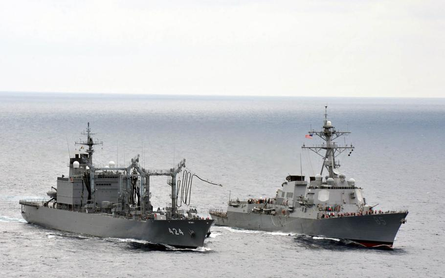 Japan Maritime Self-Defense Force fast-combat support ship JS Hamana, left, conducts a replenishment at sea with the guided-missile destroyer USS McCampbell, June 7, 2012, in the East China Sea. Japan has decided to develop and deploy a land-to-sea missile system designed to enhance defense in the East China Sea at the same time it is embroiled in a tense standoff with China over the disputed Senkaku island chain.