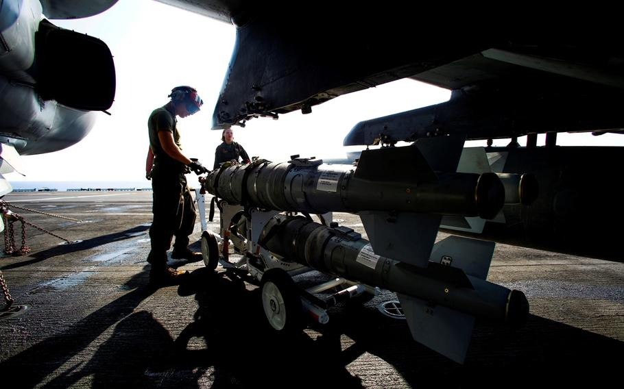 Marines from the 22nd Marine Expeditionary Unit load ordnance on an AV-8B Harrier II on the flight deck of the amphibious assault ship USS Wasp in the Mediterranean Sea, Tuesday Aug. 2, 2016. The 22nd MEU is conducting precision airstrikes against Islamic State targets in Sirte, Libya, as part of Operation Odyssey Lightning.  That mission has become a showcase for U.S. Africa Command's new capabilities.