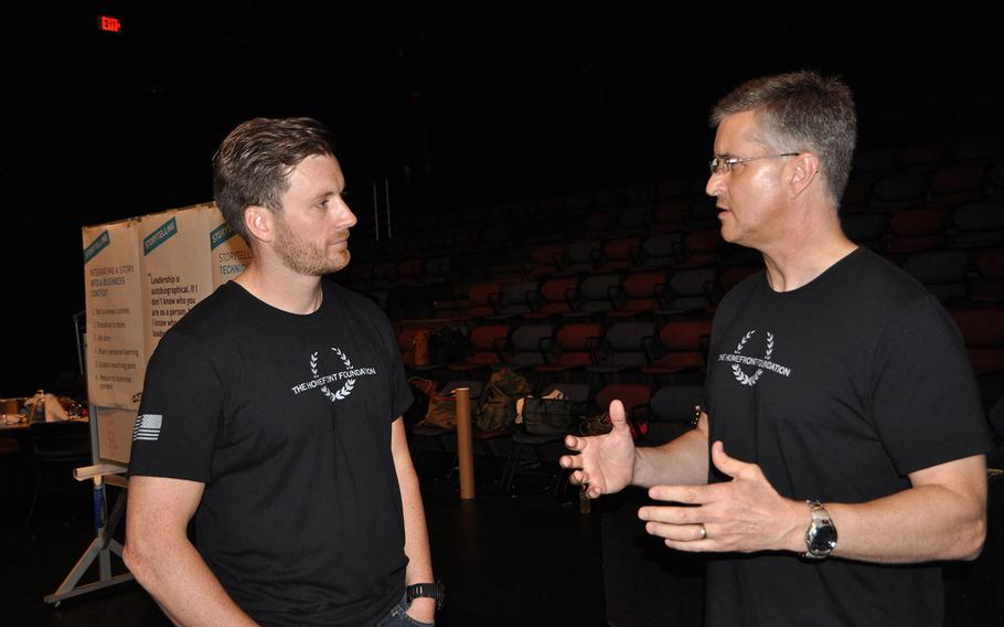 Homefront Foundation founder Matt Fetterman listens to John Roy during a storytelling workshop run by the foundation at the University of South Florida theater in Tampa on Aug. 27. The worskhop teaches storytelling to service members and first responders as a communication tool.