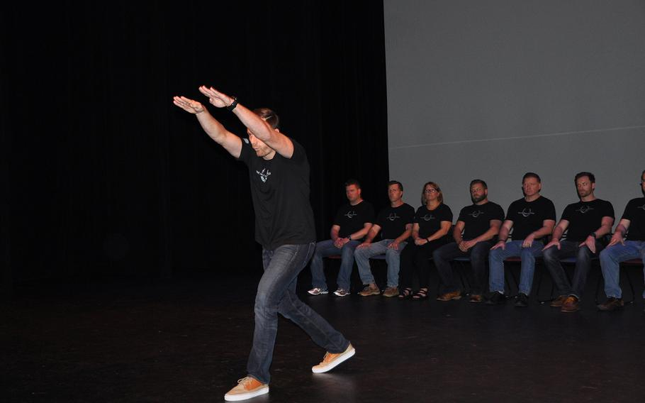 Matt Fetterman, co-founder of the Homefront Foundation, tells his story to an audience at the culmination of a one-day storytelling workshop for veterans and first responders at the University of South Florida theater in Tampa on Aug. 27.
