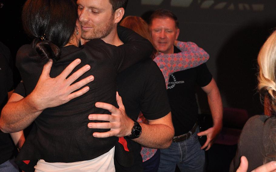 Matt Fetterman, co-founder of the Homefront Foundation, hugs his fiance after the performance by veterans and first responders at the University of South Florida theater in Tampa on Aug. 27. The performance was the culmination of a day-long storytelling workshop. Photo by Dianna Cahn