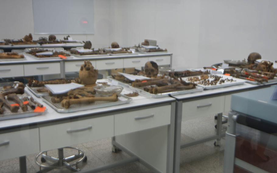 The reamins of servicemembers who died during the Korean War are examined at South Korea's Ministry of National Defense Agency for KIA Recovery and Identification, known as MAKRI, on Sept. 12, 2016, in Seoul. The remains were found by search crews who fan out on the peninsula for several months each year as part of an effort to find more than 130,000 South Koreans and 7,800 Americans who remain missing.