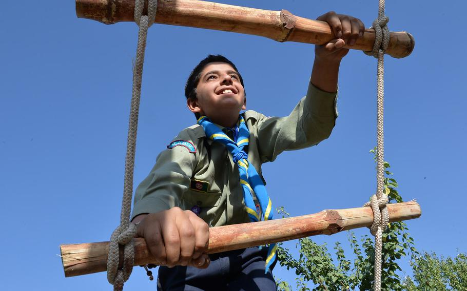 Hujatullah Stanakzai, 12, climbs a rope ladder on Sept. 8, 2016. The obstacle was part of a multistation confidence course for six Afghan scouting troops in Kabul during a three-day camping event. The scouting movement, which disappeared after the Soviet invasion in 1979, is making a comeback in Afghanistan, seen as a way of developing important life skills.
