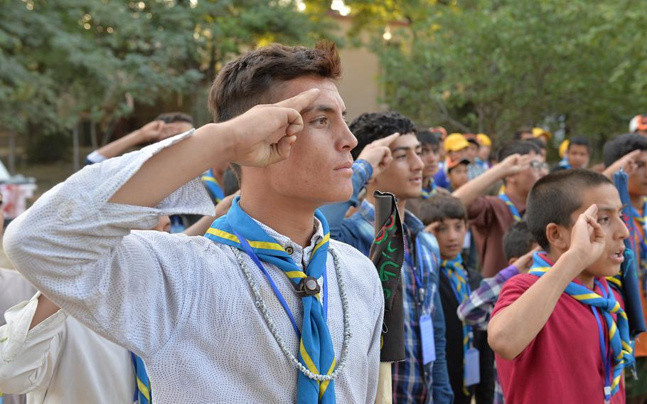 Said Khudadad Hosaini, 18, salutes during a formation for Afghanistan's Troop 3 at a three-day camping event in Kabul for six units in the country's nascent scouting program.
