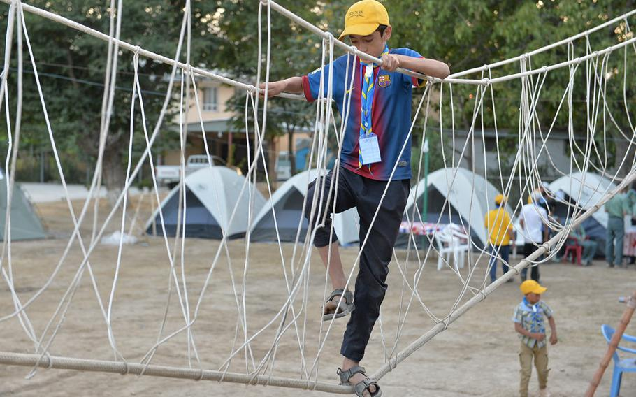Abdulrauf, 15, who like many Afghans goes by one name, crosses a monkey bridge on Sept. 8, 2016. The rope bridge obstacle was one of a series in a confidence course for 180 scouts who participated in a three-day campout in Kabul.