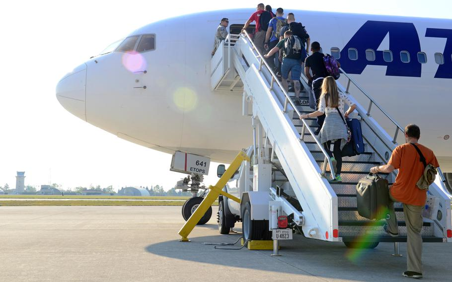Travelers board the Patriot Express rotator at Aviano Air Base, Italy, on Sept. 28, 2016. Beginning Oct. 1, 2016, the Patriot Express rotator mission will no longer be available into and out of Aviano Air Base.