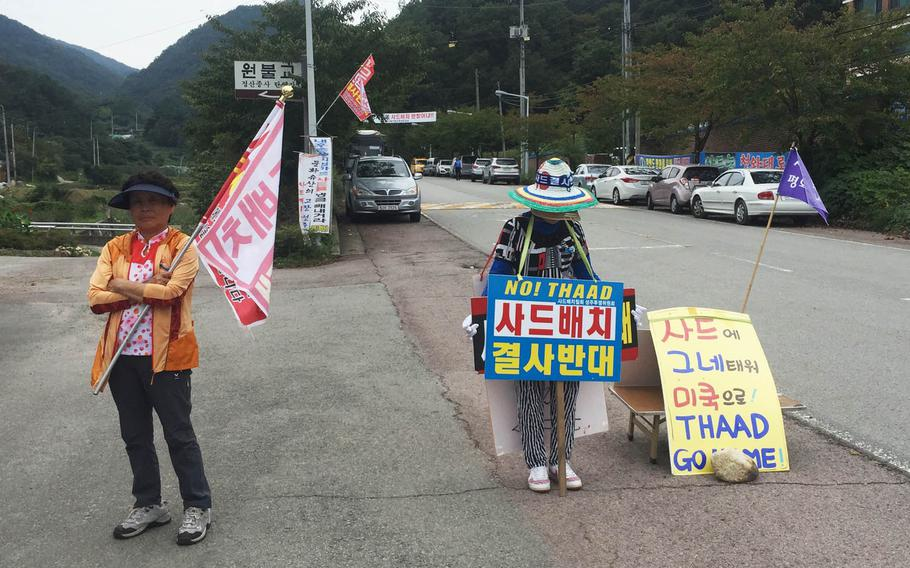 South Koreans protest U.S. and South Korean military plans to deploy an advanced U.S. missile defense system known as THAAD in the southeastern Seongju area, Wednesday, Sept. 28, 2016. They are standing near the road leading to the Lotte Skyhill Country Club, where the anti-missile battery will be stationed.