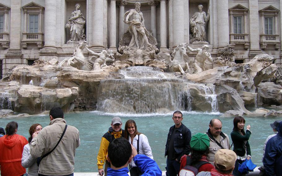 Tourists pose for photos in front of Rome's Trevi Fountain. The Islamic State group or its sympathizers have launched scores of attacks that killed hundreds and injured many more in France, Denmark, Germany, the United Kingdom, Belgium, Tunisia, Australia, Canada and the U.S., yet there have been no attacks in Italy.