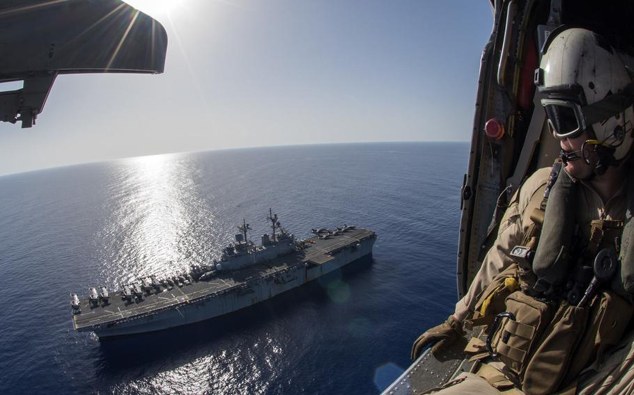 Petty Officer 1st Class Matthew Estep watches the amphibious assault ship USS Wasp transit the Mediterranean Sea on Oct. 12, 2016. The Wasp is deployed with the Wasp Amphibious Ready Group to support maritime security operations and theater security cooperation efforts in the U.S. 6th Fleet area of operations.