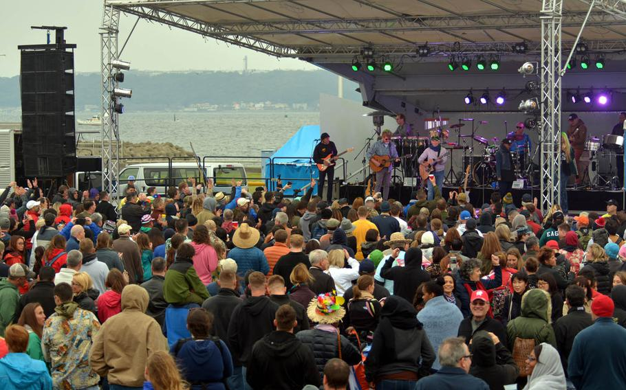 The crowd fills Berkey Field on a chilly Sunday as Jimmy Buffett and the Coral Reefer Band perform for servicemembers at Yokosuka Naval Base, Japan, Oct. 30, 2016.