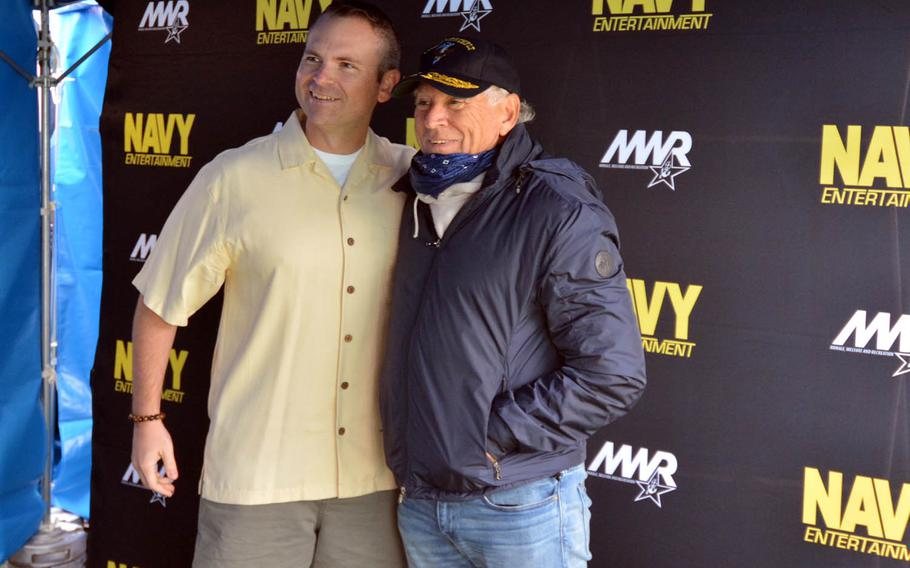 Jimmy Buffett, right, poses with a fan during a backstage meet-and-greet at Yokosuka Naval Base, Japan, Sunday, Oct. 30, 2016. Buffett performed free concerts for servicemembers at Yokosuka and on Okinawa to cap his 2016 tour.