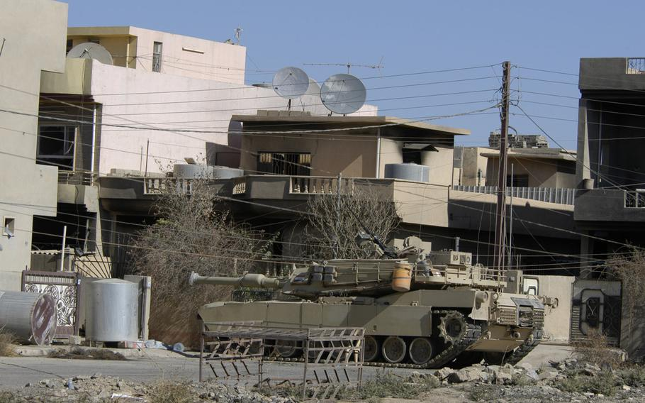 An Abrams tank with the Iraqi army's 9th Armored Division is situated near Mosul on Thursday, Nov. 3, 2016. The division entered the city limits briefly on Wednesday but later withdrew and were returning on Thursday, according to a general with the division.