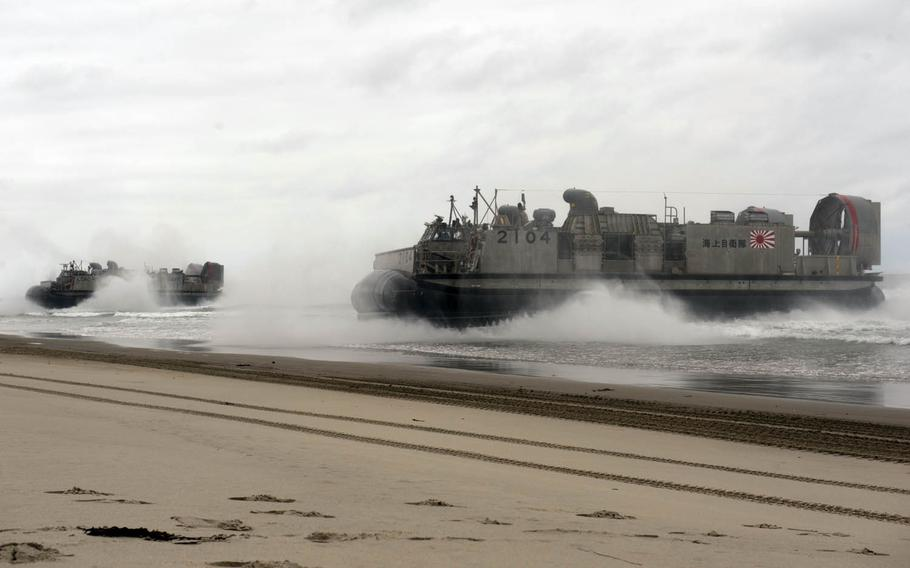 The Japan Maritime Self-Defense Force and U.S. Navy simulate a beach-front assault during a past Dawn Blitz exercise at Camp Pendleton, Calif. Japan plans to activate its 2,100-member Amphibious Rapid Deployment Brigade by March 2018.