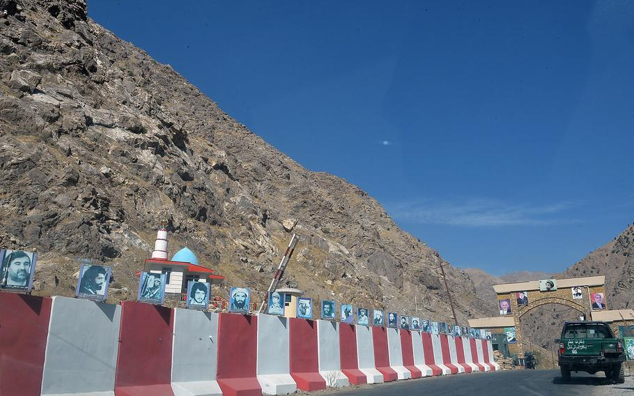 Photos of Panjshiri 'martyrs' killed in Afghanistan's nearly four decades of war line the blast walls near the entrance to the Panjshir Valley, pictured here on Oct. 13, 2016. The valley has been a bastion of resistance to the Taliban since the Islamist group took over the Afghan government in 1996.