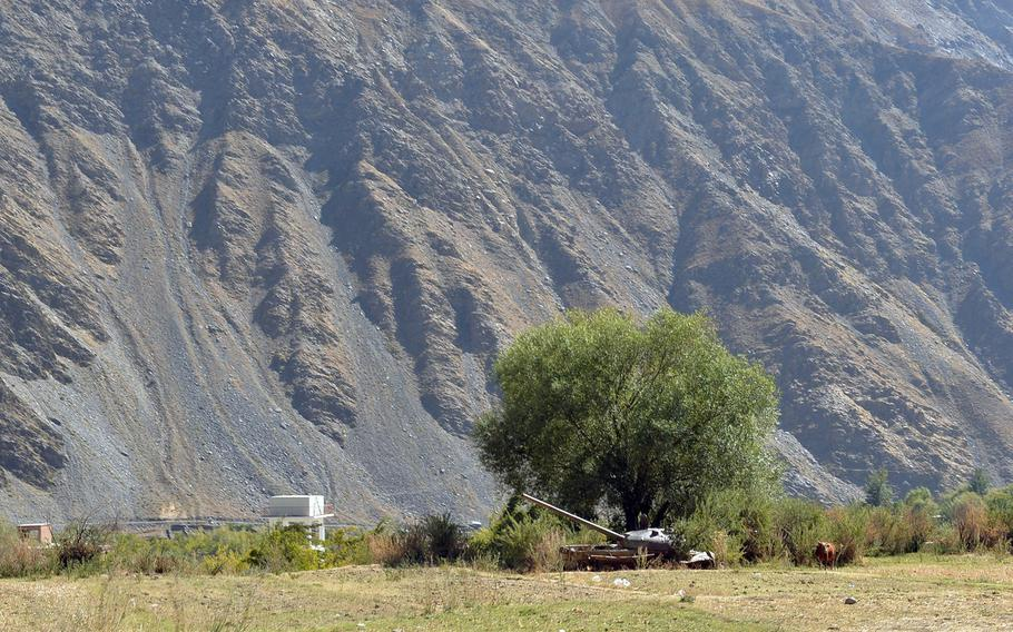 A cow grazes near a Soviet tank, one of many derelict pieces of military hardware littering the now-peaceful Panjshir Valley in central Afghanistan on Oct. 13, 2016. The valley was a guerilla stronghold during the Soviet invasion of Afghanistan in the 1980s.