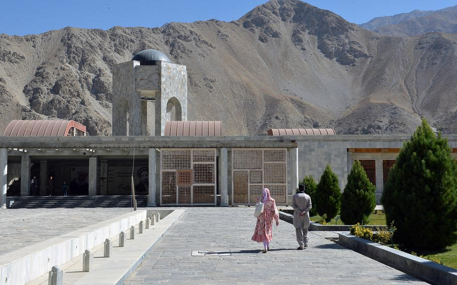 Visitors stroll along the gardens near the tomb of Ahmad Shah Massoud, an Afghan military fighter known as the 'Lion of Panjshir' who battled the Soviets and the Taliban, near the town of Bazarak in Panjshir Valley on Oct. 13, 2016. Massoud was assassinated in 2001, days before the Sept. 11 attacks in the United States. The monument surrounding his tomb, which includes gardens and fountains, is not yet complete.