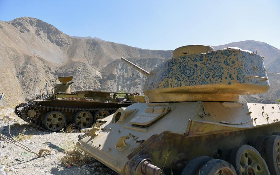 A derelict tank, pictured here on Oct. 13, 2016, has been painted gold and its turret decorated with blue paisley designs on a hilltop where Afghan mujahedeen leader Ahmed Shah Massoud is entombed near the town of Bazarak.