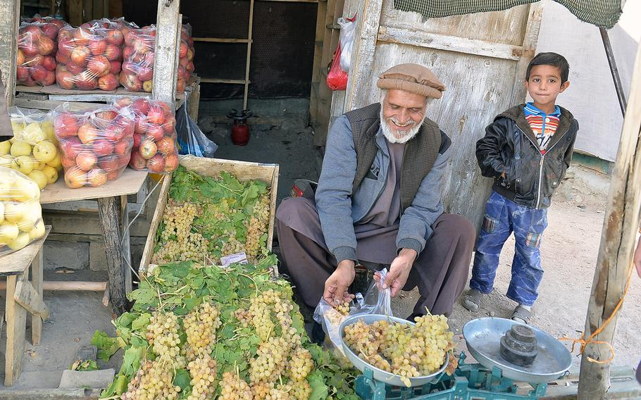 Panjshir Valley resident Abdul Ghani is pictured on Oct. 13, 2016, at his fruit stand in the town of Bazarak. He said the valley remains secure, but the people of the area are alert to violence elsewhere in the country, which they fear could arrive in their villages, too.