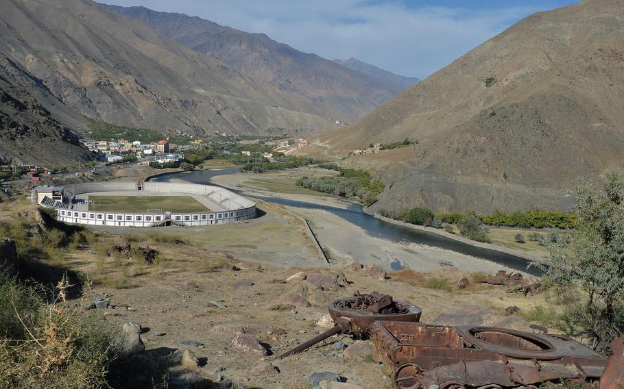 A destroyed tank rusts on a hillside overlooking the Panjshir Valley town of Parakh on Oct. 13, 2016.
