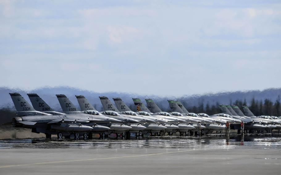 Air Force F-16 Fighting Falcons assigned to 121st Fighter Squadron, Joint Base Andrews, Md., and 112th Fighter Squadron, Toledo Air National Guard Base, Ohio, stand by for launch during drills last year at Eielson Air Force Base, Alaska.