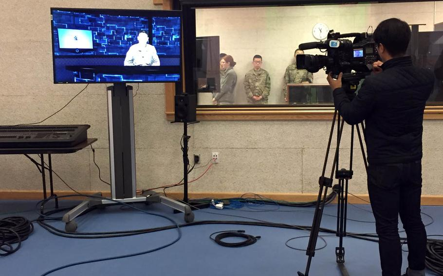 A cameraman shoots video at the new headquarters for American Forces Network Pacific Korea at Camp Humphreys, South Korea, Tuesday, Nov. 15, 2016. AFN will provide high-definition television for all channels by the end of next year, a senior official told Stars and Stripes.