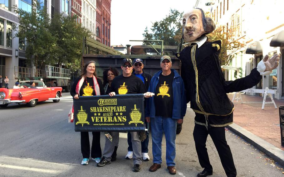 """Members of Shakespeare With Veterans, a Kentucky-based theater troupe, pose during a recent Veterans Day parade in Louisville. The group aims to provide """"the opportunity for camaraderie and a higher sense of purpose that represents what veterans loved most during military service."""""""