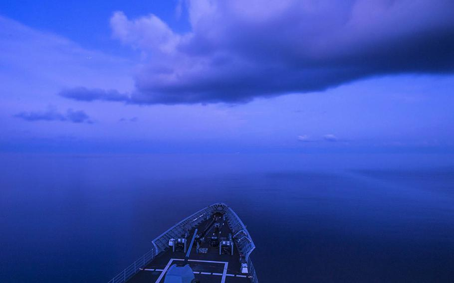 """The guided-missile cruiser USS Chancellorsville transits the South China Sea in July. Reports say China flew a nuclear-capable bomber along the so-called """"Nine-Dash Line"""" over the disputed sea last week in response to President-elect Donald Trump's historic phone call with Taiwan's president."""
