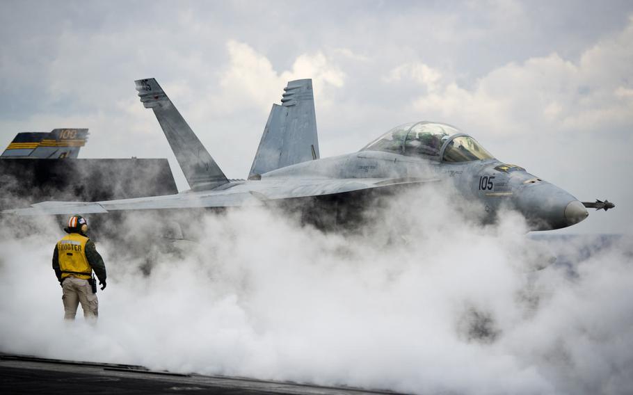 An F/A-18F Super Hornet is prepared for launch aboard the USS Dwight D. Eisenhower, Thursday, Dec. 8, 2016.