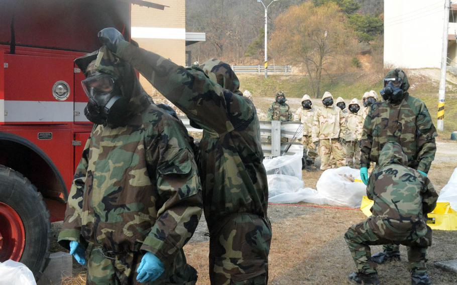 Soldiers with the 501st CBRNE Company and the Fort Riley, Kan.-based 3rd Battalion, 66th Armored Regiment, 1st Armored Brigade Combat Team, 1st Infantry Division undergo decontamination after clearing buildings and finding a mock chemical weapons laboratory during a drill at Rodriguez Live Fire Range, South Korea,  Wednesday, Dec. 7, 2016.