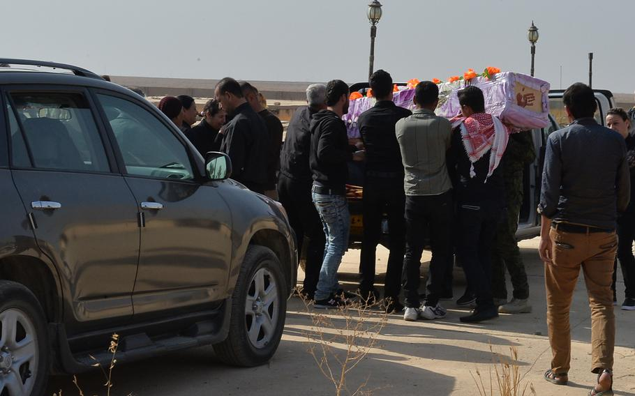 Pall bearers carry the casket of Hadiya Qreo Yohanna at a church cemetery on the edge of the Christian town of Qaraqosh, Iraq, on Nov. 14, 2016. Yohanna fled the town in 2014 as the Islamic State group swept in and died in Irbil in early November.