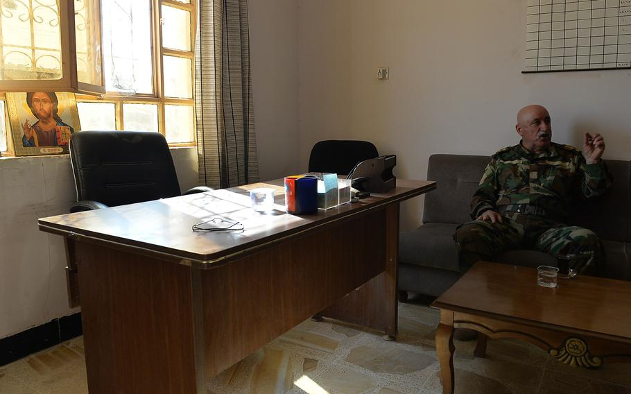 Mubarak Toaya, assistant commander of the Christian militia group Nineveh Plain Protection Units, in his office at a makeshift base for the anti-Islamic State fighters in the Christian town of Qaraqosh, Iraq, on Nov. 14, 2016.