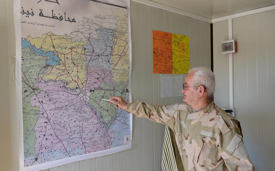 Benham Aboush Almaseh, a former Iraqi army general, points at a map at a training camp for the Nineveh Plain Protection Units near the Christian village of Alqosh on Saturday, July 23, 2016. Almaseh founded the militia to help retake the area from the Islamic State.