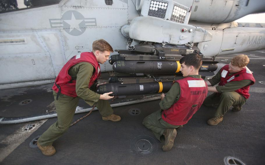 U.S. Marines with the 22nd Marine Expeditionary Unit attach AGM-114 Hellfire missiles onto an AH-1W Super Cobra aboard the amphibious transport dock ship USS San Antonio in support of Operation Odyssey Lightning, Nov. 8, 2016. U.S. Africa Command has ended its airstrike campaign against the Islamic State group in Libya.